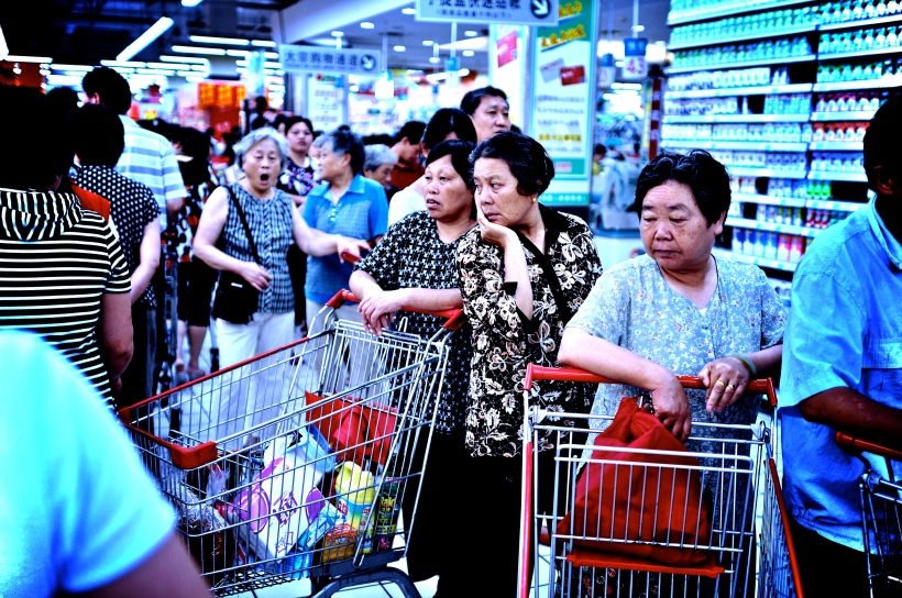 Shoppers queuing at a till